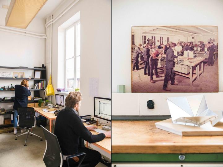 Рабочие столы и картина на стене в офисе и мастерской