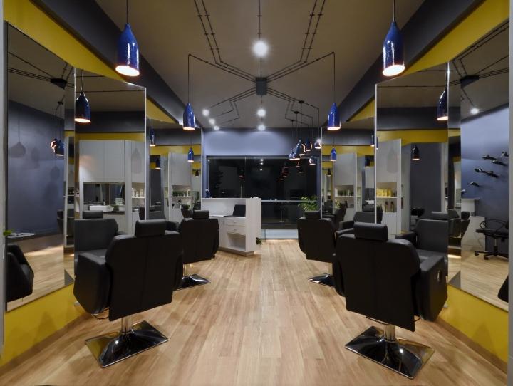 Ярко-жёлтые стены в дизайне парикмахерской