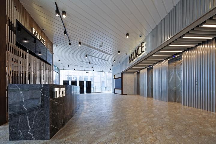 Оформление кинотеатра Palace Cinema в Китае: мраморная зона ресепшен